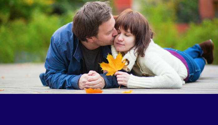 Premarital mediation. Image of man kissing woman's cheek.